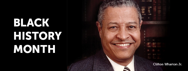"Portrait of Clifton Wharton Jr. with ""Black History Month"" in white letters on a black background to the left of the image"
